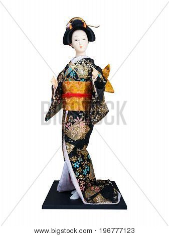 Japanese geisha doll isolated on white background.
