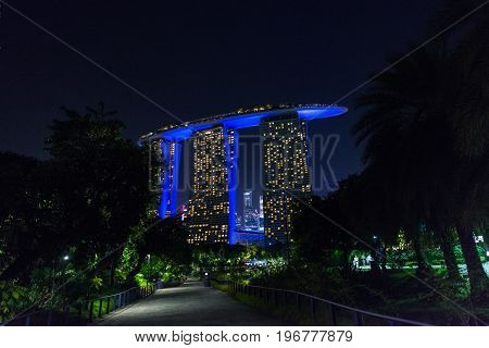 SINGAPORE - MARCH 22 2017: From the Gardens by the bay night shoot of of Marina Bay Sands Hotel Landmark of Singapore.