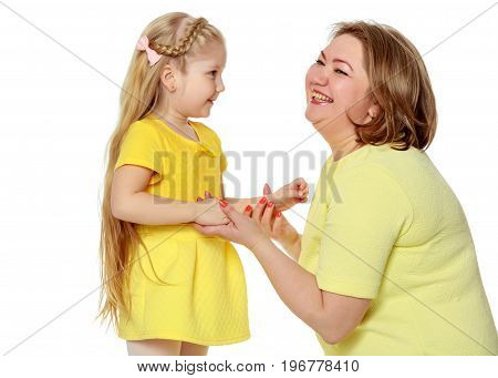 Young blonde mother, gently hugs her favorite little round-faced daughter. Family Idyll.Isolated on white background.
