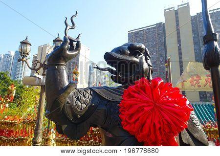 HONG KONG, CHINA - JANUARY 22, 2017: Beautiful dragon statue made of bronze at Wong Tai Sin temple in Hong Kong, China.