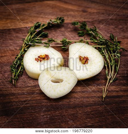 Playing around with my food. Large gloves of garlic sliced and arranged to look like a face. With fresh thyme herbs arranged to appear like hair and eye brows.