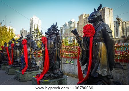 HONG KONG, CHINA - JANUARY 22, 2017: Stoned statues made of bronze at the enter of Wong Tai Sin temple enter in Hong Kong, China.