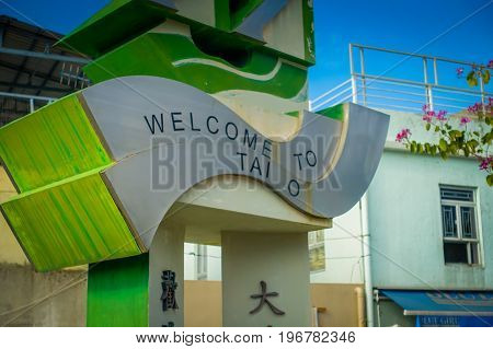 HONG KONG, CHINA - JANUARY 26, 2017: Stoned structure with an welcome sign in the enter of the fishermen town in lantau, Hong Kong, China.
