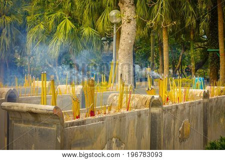 Buddhist prayer sticks burning in the censer in Po Lin Monastery, Lantau Island in Hong Kong.