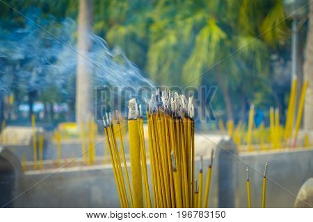 Close up of Buddhist prayer sticks burning in the censer in Po Lin Monastery, Lantau Island in Hong Kong.