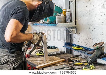 Man Grinder Metal An Angle Grinder