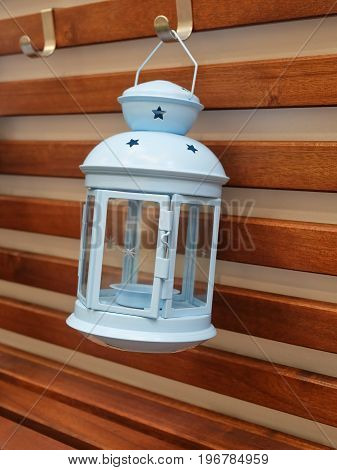 Decorative Light Blue Vintage Lantern Hanging on A Wooden Wall Used to Illuminate Surrounding Space for Decorations and Atmosphere.