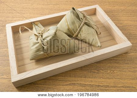 Chinese Cuisine Delicious Zongzi or Sticky Rice Dumpling Served on A Wooden Tray for Dragon Boat Festival.
