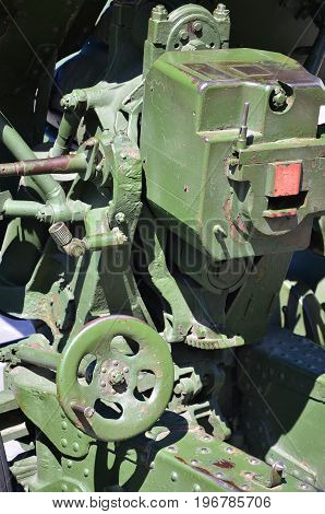A Close-up Mechanism Of A Portable Weapon Of The Soviet Union Of World War Ii, Painted In A Dark Gre