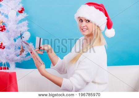 Woman Buying Christmas Gifts Online