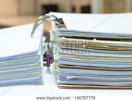 Pile of papers and business documents in document file on white table at workplace,business concept,,office supplies.