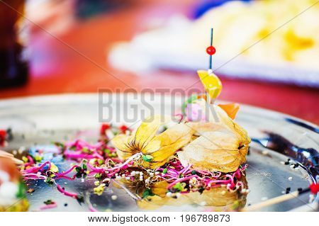 Close view of metal plate with colorful food residues