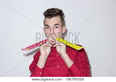 One Caucasian Teenager Blowing Party Two Double Horn, Looking To Camera, White Background Studio, Re
