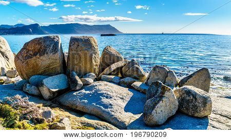 Large granite boulders at Boulders Beach, a popular nature reserve and home to a colony of African Penguins, in the village of Simons Town in the Cape Peninsula of South Africa