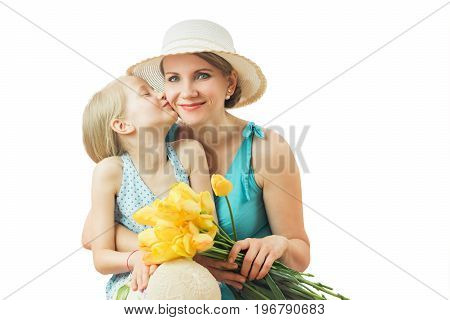 The mother and daughter and a bouquet of yellow tulips isolated on white background. The concept of a happy family.