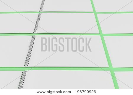 Blank White Notebook With Metal Spiral Bound On Green Background