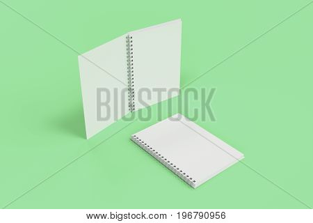 Two Notebooks With Spiral Bound On Green Background