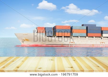 Cargo freight ship and cargo container in sea with blue sky for logistics and transportation background.