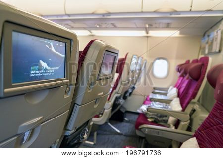 MOSCOW, RUSSIA - CIRCA MAY, 2017: a seat-back screen inside the cabin of Qatar Airways Airbus A321. Qatar Airways, is the state-owned flag carrier of Qatar.