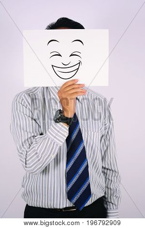 young Businessman Wearing Happy Laughing Face Mask
