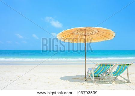 Blue sea and white sand beach with beach chairs and parasol at Samed island Thailand - holiday and vacation concepts