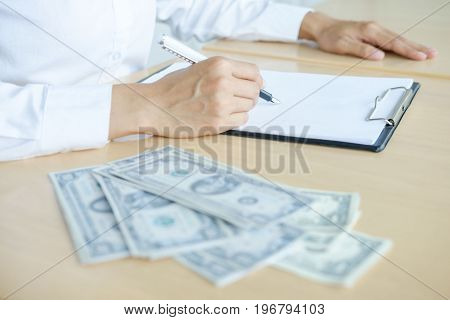 Accountant or banker calculating balance. finances investment economy saving money or insurance concept