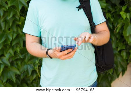 Close up of a man using mobile smart phone.