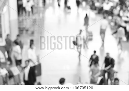Blurred people at the airport hallway in black and white can be used as background