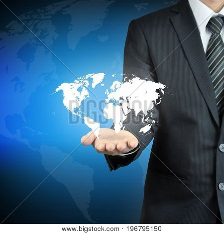 Businessman hand carrying world map - worldwide services rule the world world domination concepts etc.