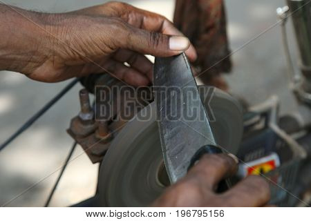 sharpening the knife with whetstone in india