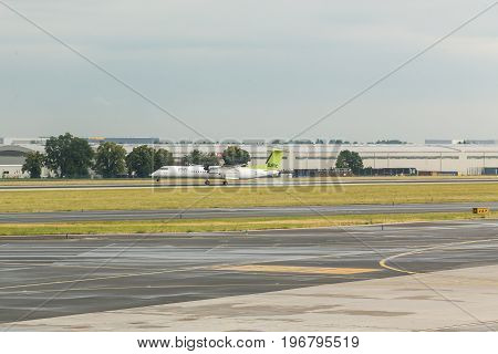 PRAGUE, CZECH REPUBLIC - JUNE 16, 2017: Boeing of Air Baltic airlines landing at Vaclav Havel Prague International Airport, Ruzyne, Czech Republic