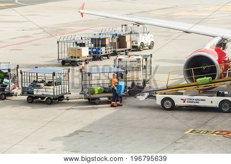 PRAGUE, CZECH REPUBLIC - JUNE 16, 2017: Vaclav Havel Prague International Airport, Ruzyne, Czech Republic. Loading luggage in the airplane.