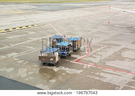 PRAGUE, CZECH REPUBLIC - JUNE 16, 2017: Vaclav Havel Prague International Airport, Ruzyne, Czech Republic. Personnel loading luggage into a plane in an airport.
