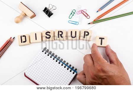 Disrupt concept. Wooden letters on a white background.