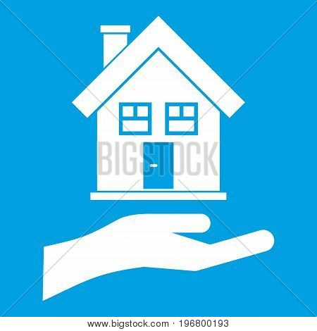 Hand holding house icon white isolated on blue background vector illustration