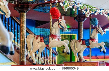 Nice France - May 27 2017: Colorful decor of the high end restaurant La Rotonde inside the famous hotel Negresco representing the horses of a carousel
