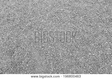 Surface of gray gravel road background for design backdrop in your work.