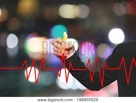 hand of business woman using yellow pen write business line graph on tall building background in concepts profit and investment.
