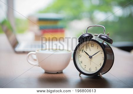 Retro Alarm Clock With Cup Of Cappuccino On Table In Office, Coffee Break Time