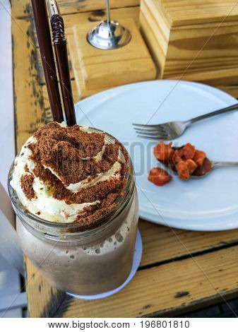 Cool cocoa drinks with salmon on the table.