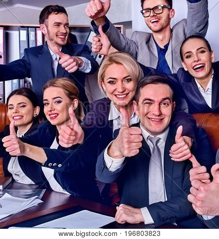 Business people office life of team people happy sitting table . People in business suits are happy from successful deal and wish success to everyone around them. Successful execution of the project.