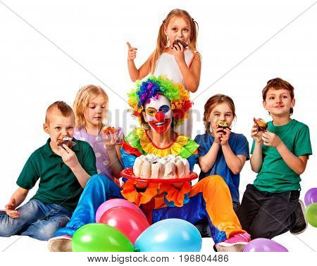 Birthday child clown playing with children and bunny fingers prank. Kid holiday cakes celebratory and balloons happiest birthday. Children are friends in team.