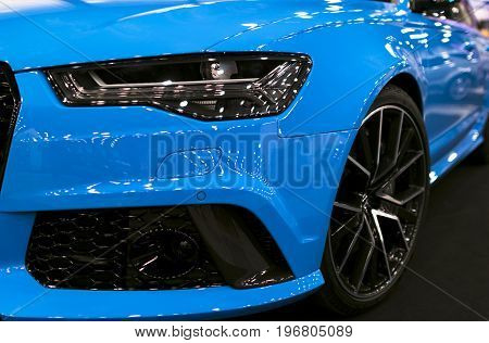 Sankt-Petersburg Russia July 21 2017: Front view of a blue modern luxury sport car Audi RS 6 Avant Quattro 2017. Car exterior details. Photo Taken on Royal Auto Show July 21