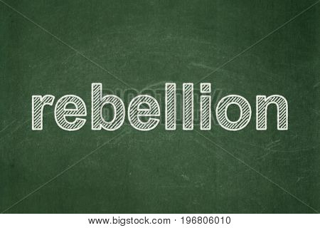 Political concept: text Rebellion on Green chalkboard background
