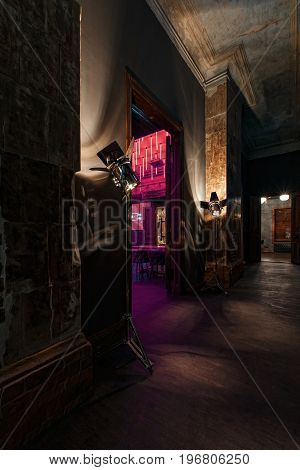 vintage high doors in the mansion converted into a nightclub. loft style. red brick