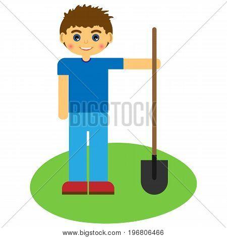 Boy with a shovel on green grass.