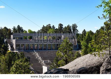 KEYSTONE, SOUTH DAKOTA - JUNE 23, 2017: tourists gather at the Grand View Terrace above Amphitheater at Mount Rushmore, seen from the Presidential Trail.