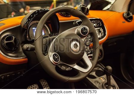SAINT-PETERSBURG, RUSSIA - JULE 23, 2017: Car Interior of New Mercedes Smart Fortwo. Close up of Car steering wheel and dashboard panel.