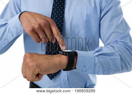 Close up of businessman using smartwatch against white background