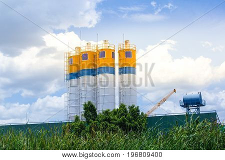 Cement concrete mixing production factory with morning light and blue sky backgroundBusiness of cement factory
